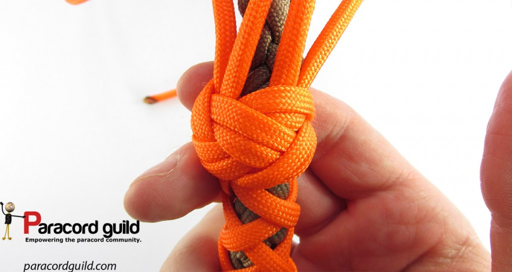 Lanyard knot finish to the overlay.