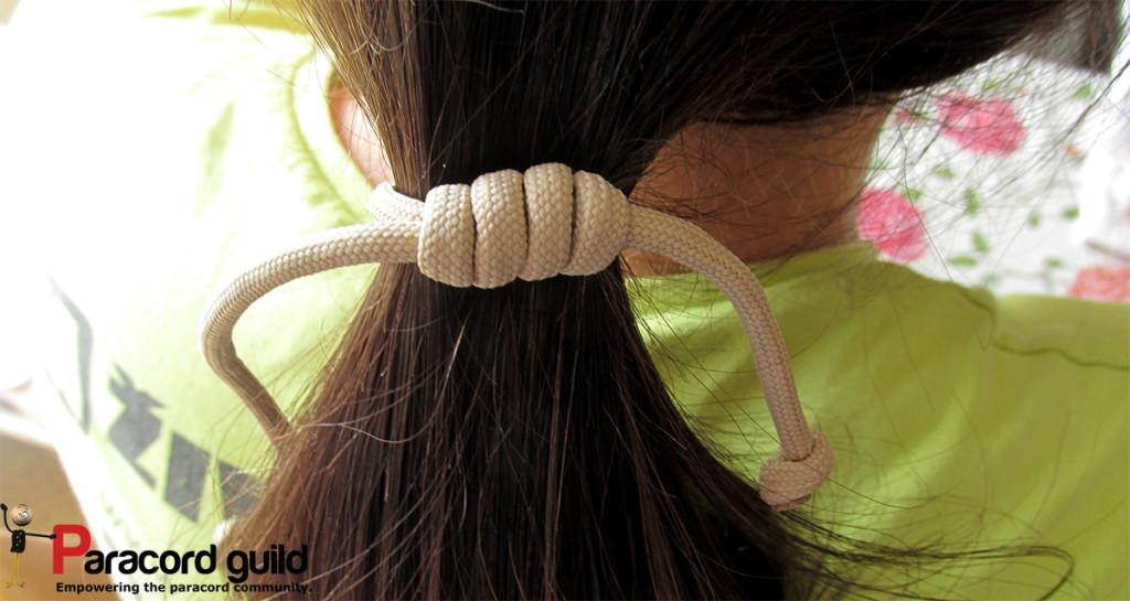 Girlfriend in her natural habitat. Note the hair strap/bracelet.