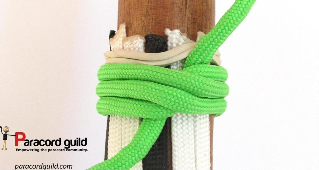 Cords secured for plaiting with the use of the Strangle knot.