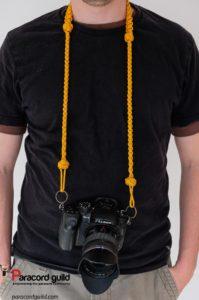 Camera strap in use.